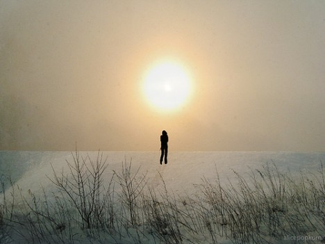 Man in snow sunlight